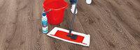 Чем очистить линолеум от клея?