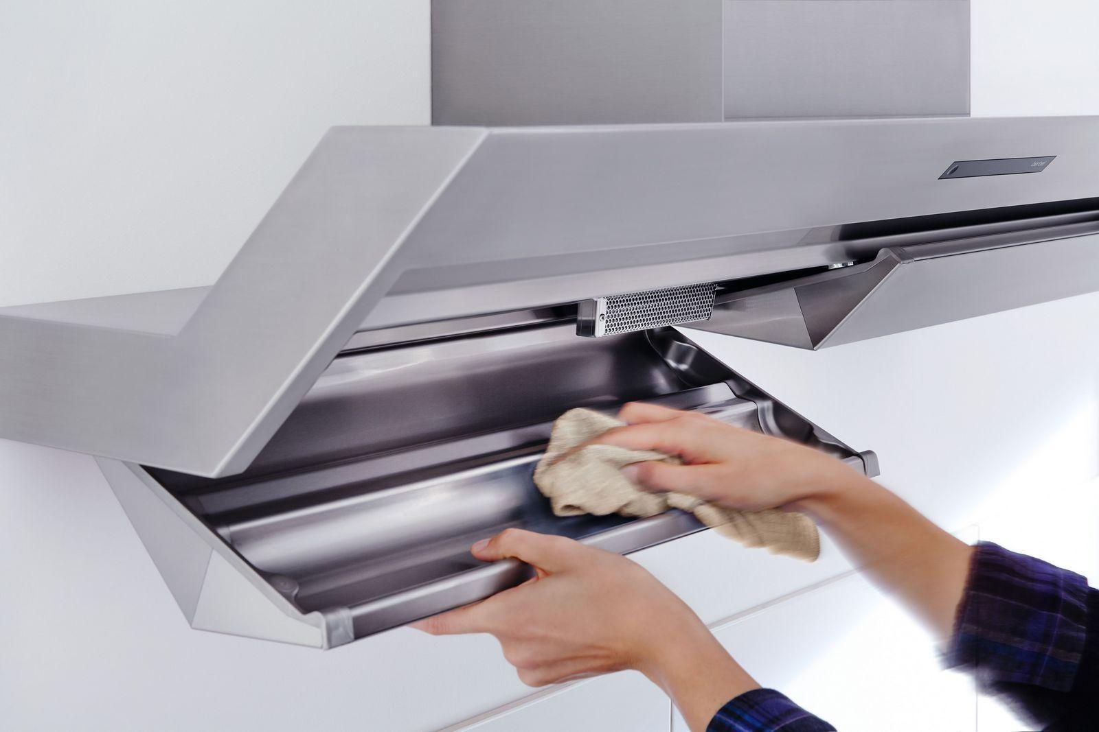 Чем очистить жир с вытяжки на кухне